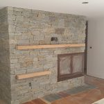 antique granite fireplace